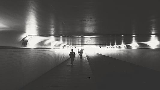 man walking on tunnel