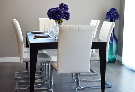 rectangular black wooden table with chairs dining set