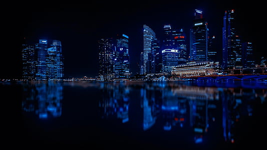 reflective photo of city of at night