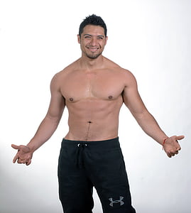 topless man wearing black Under Armour bottoms