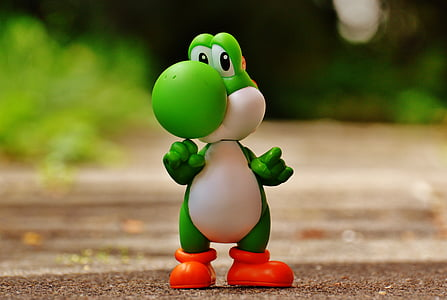 Yoshi plastic figure on brown surface