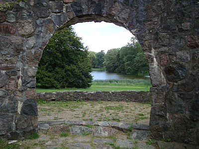 brown concrete arc door