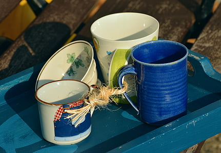 assorted-color ceramic mugs and bowl