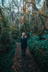 woman wearing green collared long-sleeved dress on forest during daytime