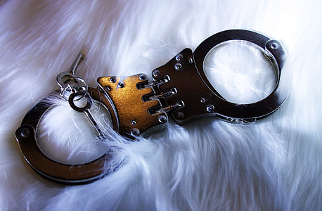 gold and silver handcuffs with keys