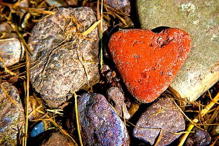orange heart painted stone