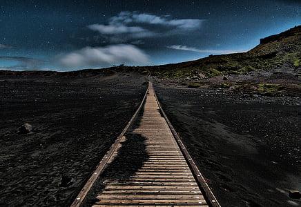 brown rail road at night