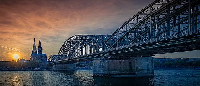 gray bridge under sunset