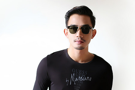 man wearing black Guess scoop-neck shirt