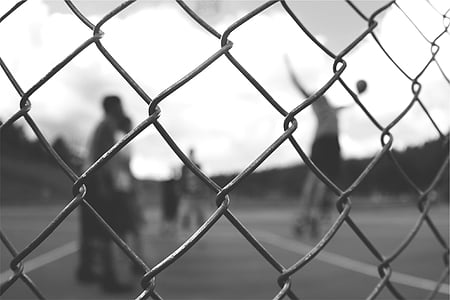 grayscale photography of cyclone fence
