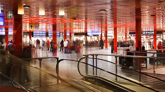 time-lapse photograph of people near escalator