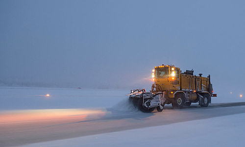 yellow vehicle with disc plow
