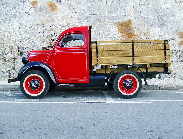 red stake truck on road