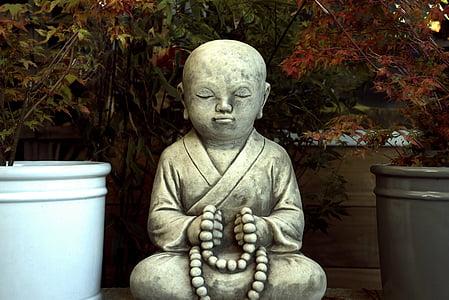 monk concrete statue