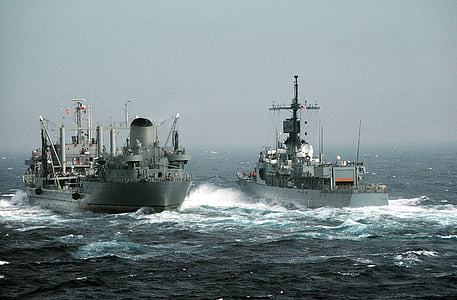 photographed of two gray and white ships