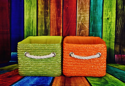 two green and orange fabric baskets on multicolored wooden pallets