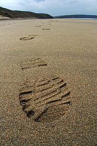 shoe prints in the sand photography