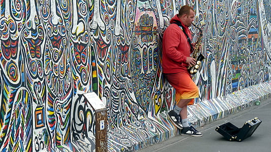 man playing saxophone on the street