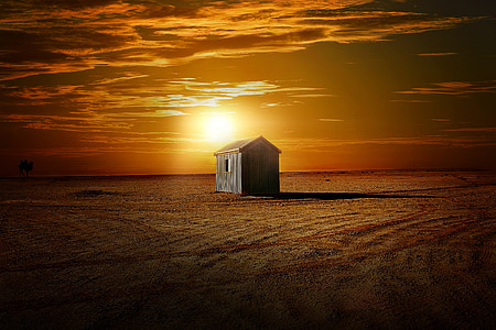 gray wooden house during sunset