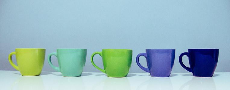five assorted-color ceramic mugs