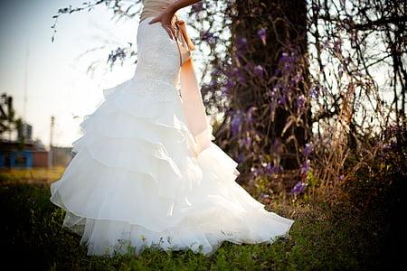 woman wearing white layered dress