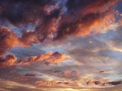 scarlet skies with clouds