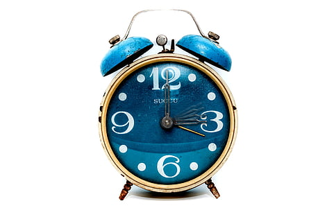 brown and blue alarm clock at 12:15