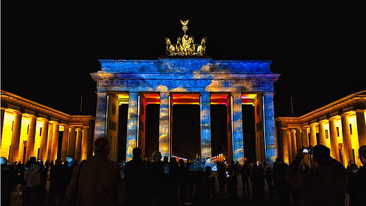 people at Brandenburg Gate at night