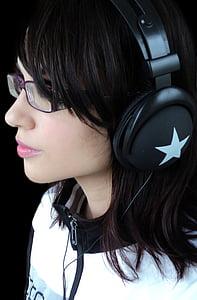 woman wearing black headphones