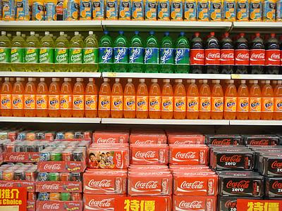 soda bottle and box lot on shelf