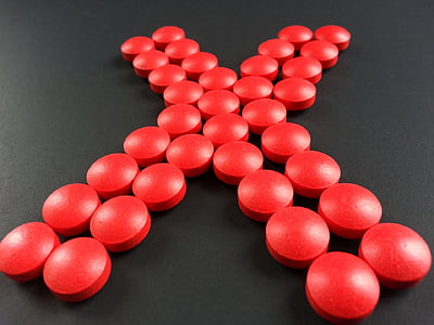 round red medication pill forming X