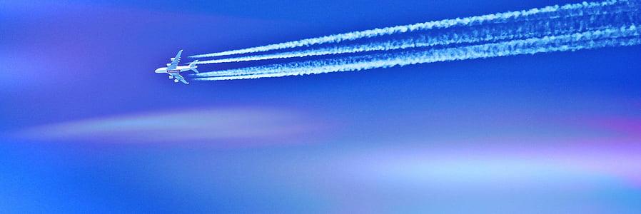 photograph of white jet plane