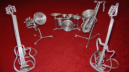 grey stainless steel band instrument statuettes
