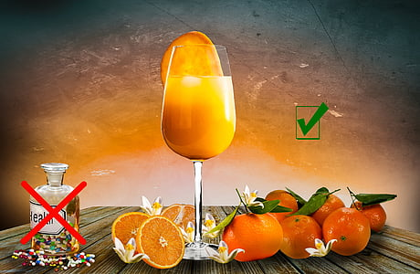 orange fruit and juice on wooden table painting