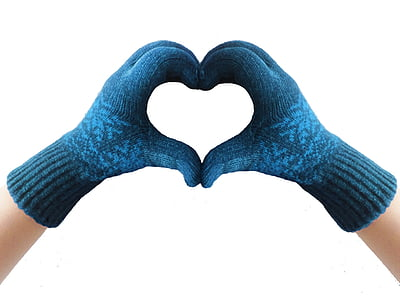 photo of person forming hand heart gesture