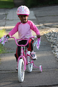 girl riding bicycle
