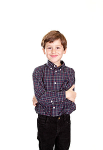 boy wearing black, white, and red flannel shirt