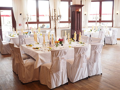 rectangular white table and chairs on floor