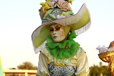 person wearing masquerade mask