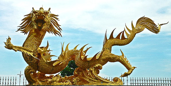 shallow focus of gold dragon statue