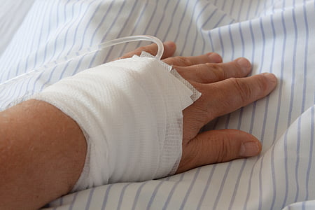 person's hand with dextrose