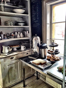gray stainless steel coffee pot near cupcakes