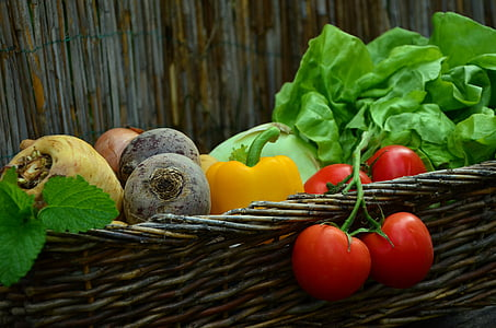 assorted-color vegetable lot on brown wicker basket