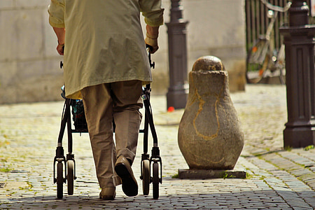 man walking with stroller