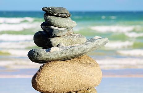 stacked rocks near seashore