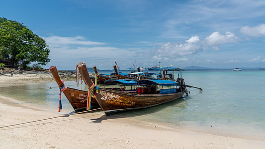 two brown-and-blue fishing boats