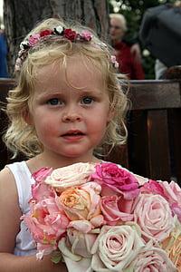 girl carrying flower bouquet