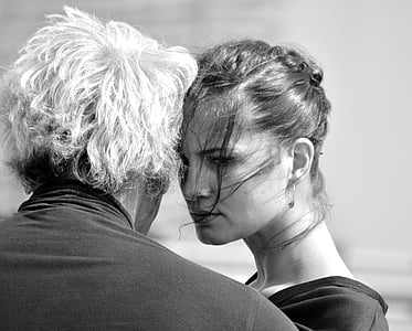 black and white photo of couple facing each other