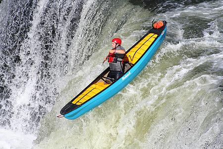 person on teal kayak during daytime