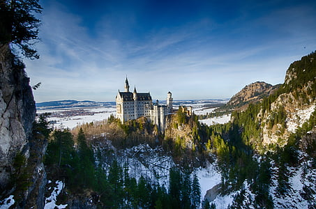 white concrete castle near mountain